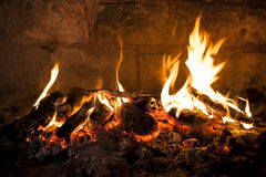 Fireplace with a blazing flamees. Stock Photo
