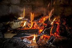 Fireplace with a blazing flames. Royalty Free Stock Images