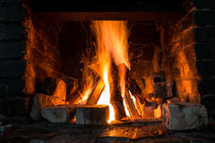 Fireplace. From bricks with burning fire stock image