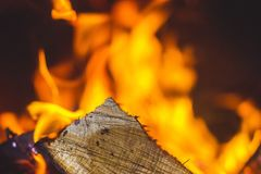 In the fireplace a bright fire burns wood, warms the room and cr. Eates a cosiness Royalty Free Stock Image
