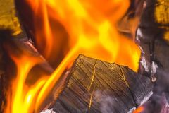 In the fireplace a bright fire burns wood, warms the room and cr. Eates a cosiness Stock Photo