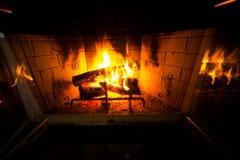 Fireplace buring wood. Wood burning fireplace burning wood creating colorful light royalty free stock image