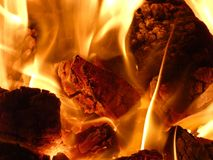 Fireplace - Burning Coal Lumps. Red hot fire flames Royalty Free Stock Photos