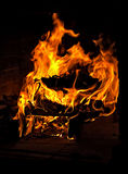 Fireplace. Burning fire of a fireplace in a country house in the winter cold Stock Photo