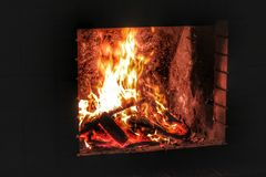 Fireplace with a burning fire in the house. Burning firewood Royalty Free Stock Image