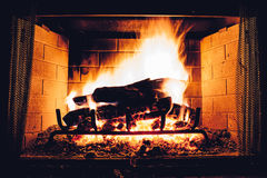 Fireplace with burning logs Royalty Free Stock Photography