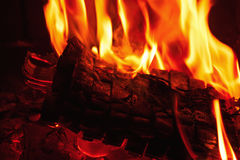 Fireplace burning. Warm burning and glowing fire in fireplace. Royalty Free Stock Image