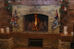 Fireplace burning. Warm cozy burning fire. In a brick fireplace close up. Cozy background Royalty Free Stock Photos