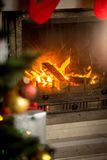 Fireplace with with burning wood logs decorated for Christmas Stock Images