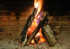Fireplace with burning woods. Stock Photos