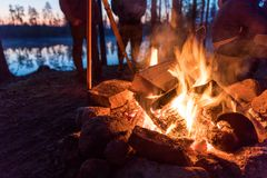 Fireplace in camping near lake. At dark night royalty free stock photography