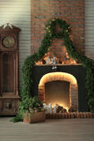 Fireplace with candles and pine needles Stock Photo