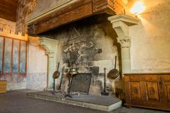 Fireplace in a castle Stock Images