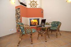 Fireplace and chairs Royalty Free Stock Images