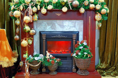 Fireplace with a christmas decoration Stock Images