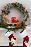 Fireplace with Christmas pine wreath decorations stock images