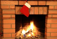 Fireplace with christmas sock Stock Photo