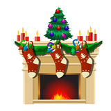 Fireplace with Christmas tree and gifts socks Stock Photography