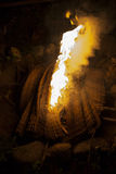 Fireplace. Close up of the bonfire with burning bamboo mat soft focus dark background Royalty Free Stock Photos