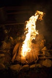 Fireplace. Close up of the bonfire with burning bamboo mat soft focus dark background Stock Images