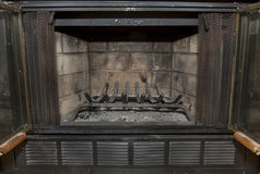 Fireplace. Interior of a dirty fireplace, with a metal wood rack royalty free stock photos