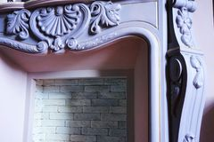 Fireplace close-up indoors gray pink color detail. Architecture royalty free stock image