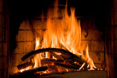 Fireplace closeup. A closeup photo of fireplace with logs and ash Royalty Free Stock Photography