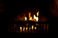 Fireplace. Closeup in dark room .shallow DOF Royalty Free Stock Image