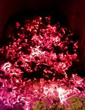 Fireplace coals. Red fireplace coals still burning in the fireplace stock photo
