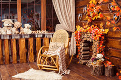 Free Fireplace Collected From Logs, Rocking-chair And Furs In The Room Royalty Free Stock Photos - 76917898
