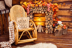 Fireplace collected from logs, rocking-chair and furs royalty free stock photos