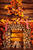 Fireplace collected from logs in room with wooden walls stock photos