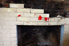 Fireplace Detail. Ruins of an old fire place in an abandoned home after a fire stock images