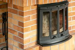 Fireplace, detail of home interior. Fireplace covered with fireclay bricks royalty free stock photography