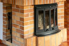 Fireplace, detail of home interior. Fireplace covered with fireclay bricks royalty free stock image