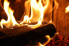 Fireplace detail. Detail shot of a burning log in an indoor fireplace royalty free stock photos