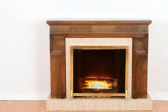 Fireplace with fake fire. On a wood floor Stock Images