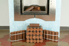 Fireplace with fake wood Stock Photo