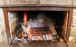 Fireplace with fire. (Winter season Stock Images