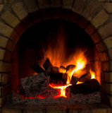 Fireplace. A fire burns in a fireplace Royalty Free Stock Photography