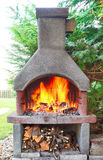 Fireplace with fire. Stock Photo