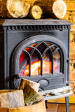 Fireplace with fire flame and firewood in barrel interior. Heating. Stock Image