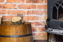 Fireplace with fire flame and firewood in barrel interior. Heating. Stock Photography