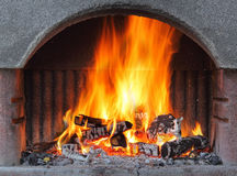 Fireplace with fire at night - outdoor shot Stock Images