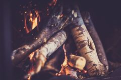 Fireplace. Burning woodpile background, cozy romantic winter evening near fire place Stock Photography