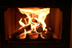 Fireplace. Firewood burn in the fire. The fire in the fireplace. Close-up Stock Images