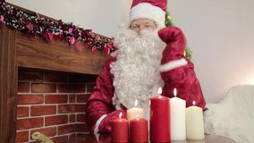 Fireplace with Garland. In the fireplace, firewood is decorated with a bright garland before Christmas stock video footage
