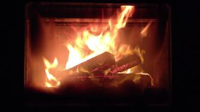 Fireplace. Flames burning in the dark stock video