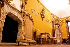 Fireplace and furniture in the original 17 century cabinet Royalty Free Stock Photos