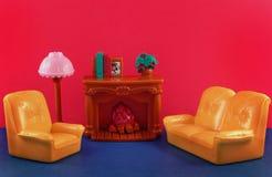 Fireplace, furniture, sofa. Toy fireplace, sofa, lamp, armchair Stock Photography